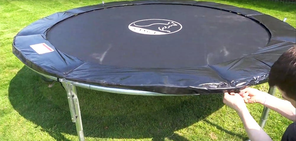 add the trampoline mat and tie it down