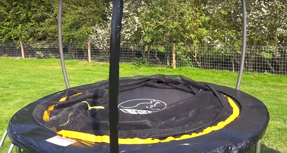 16. add the covers to the trampoline poles