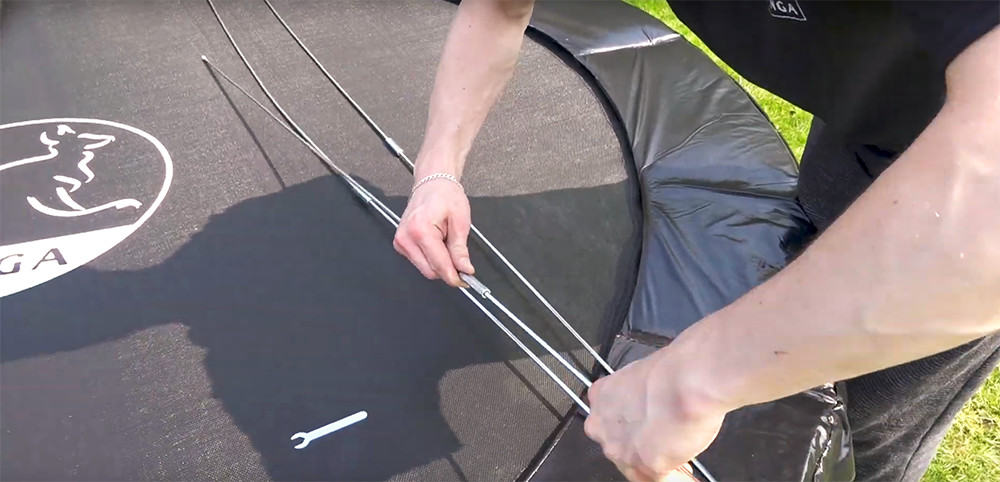 screw the trampoline rods together