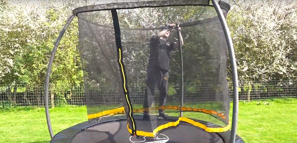 21. slot and attach the trampoline net to the poles